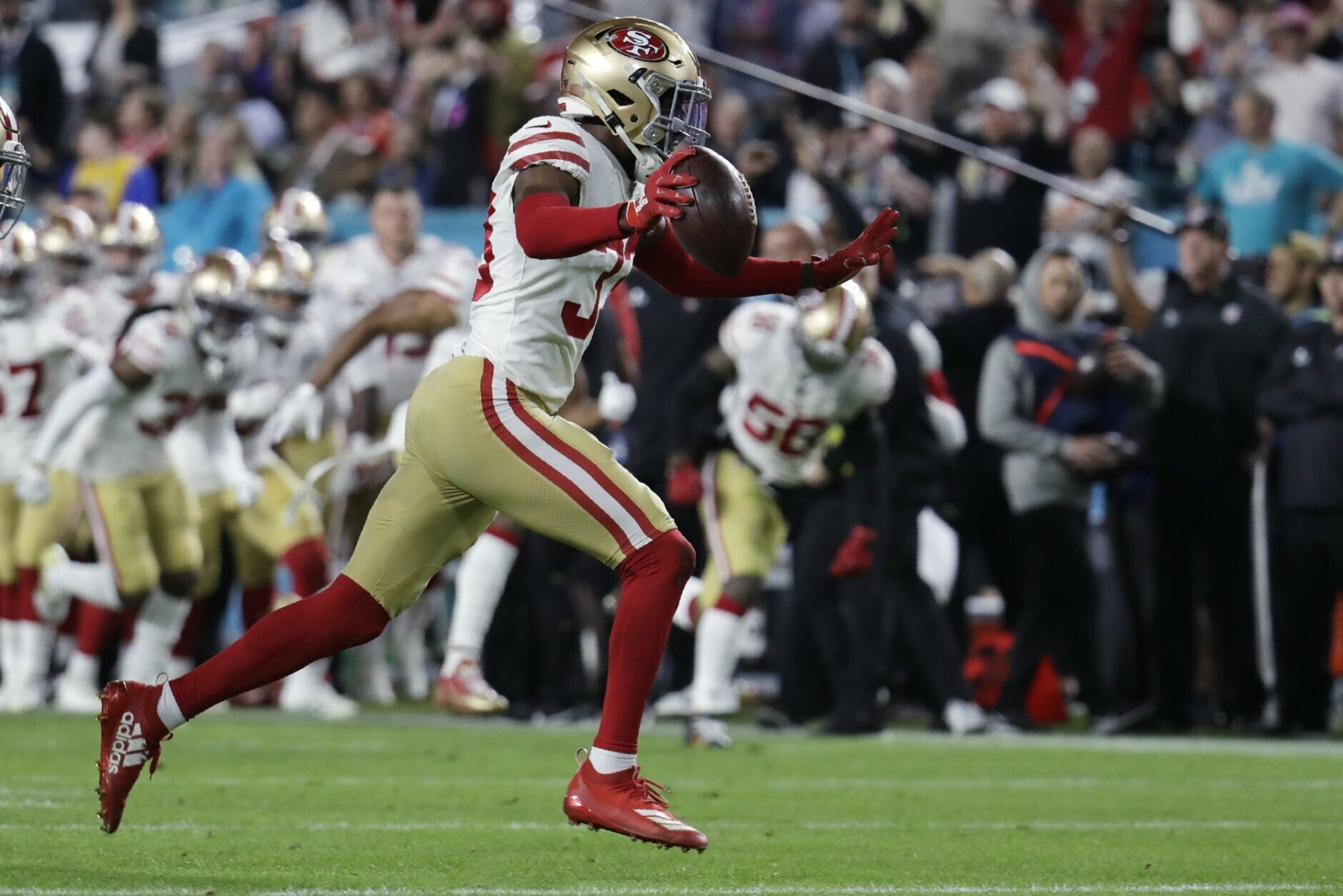 San Francisco 49ers' Tarvarius Moore, right, celebrates after intercepting a pass against the Kansas City Chiefs during the second half of the NFL Super Bowl 54 football game, Sunday, Feb. 2, 2020, in Miami Gardens, Fla. (AP Photo/Lynne Sladky)