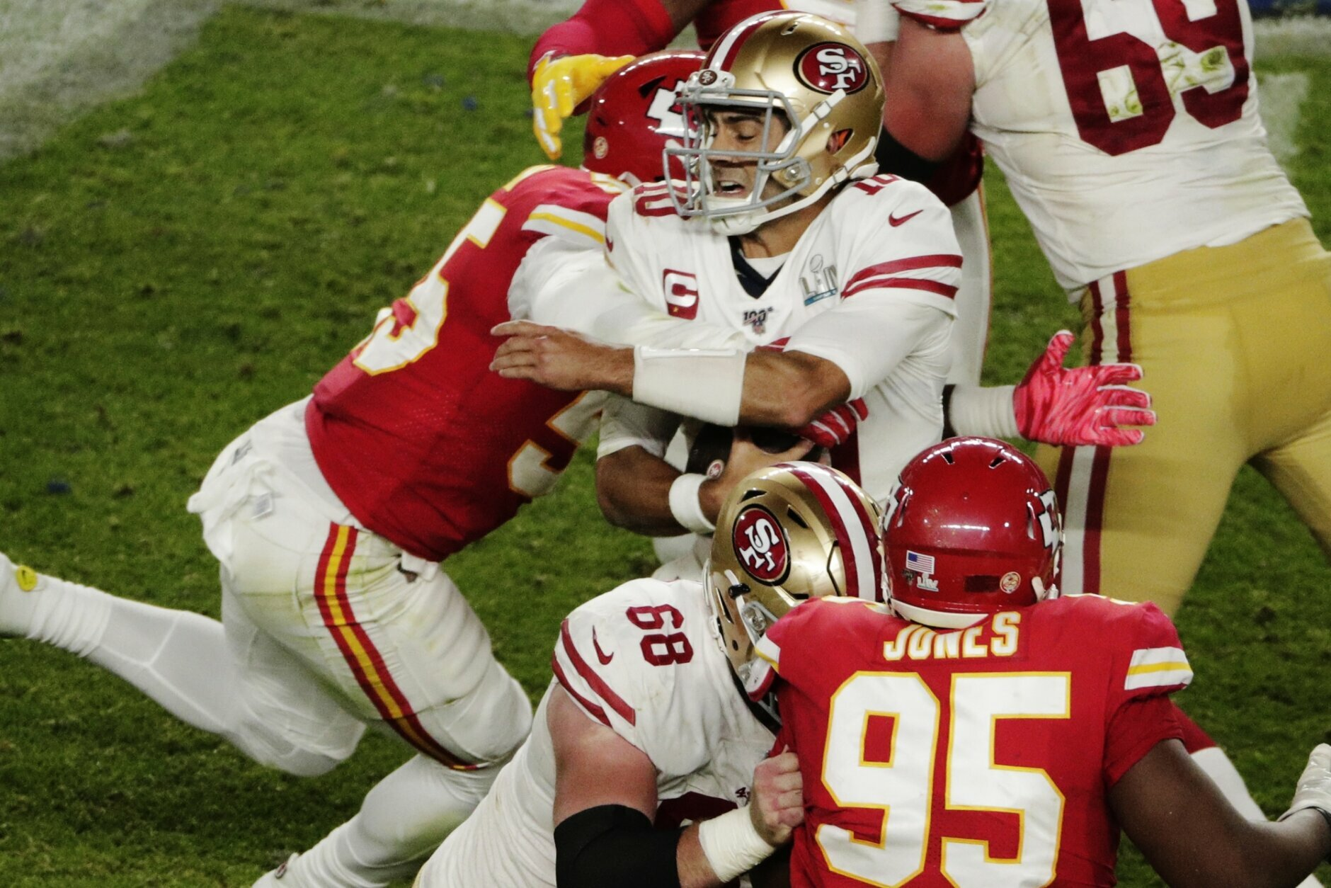 Kansas City Chiefs' Frank Clark (55) sacks San Francisco 49ers quarterback Jimmy Garoppolo (10), during the second half of the NFL Super Bowl 54 football game Sunday, Feb. 2, 2020, in Miami Gardens, Fla. (AP Photo/Charlie Riedel)