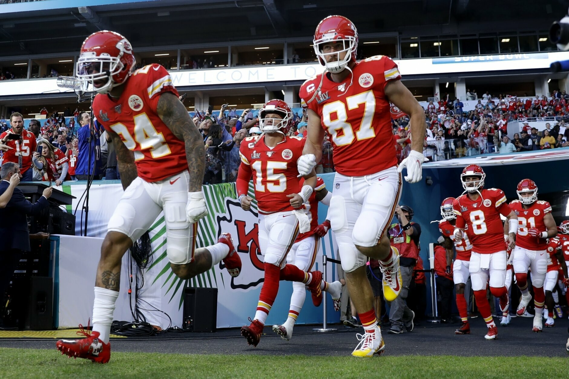 Kansas City Chiefs' Jordan Lucas (24), quarterback Patrick Mahomes (15) and Travis Kelce (87) take the field before the NFL Super Bowl 54 football game between the San Francisco 49ers and Kansas City Chiefs Sunday, Feb. 2, 2020, in Miami Gardens, Fla. (AP Photo/Seth Wenig)