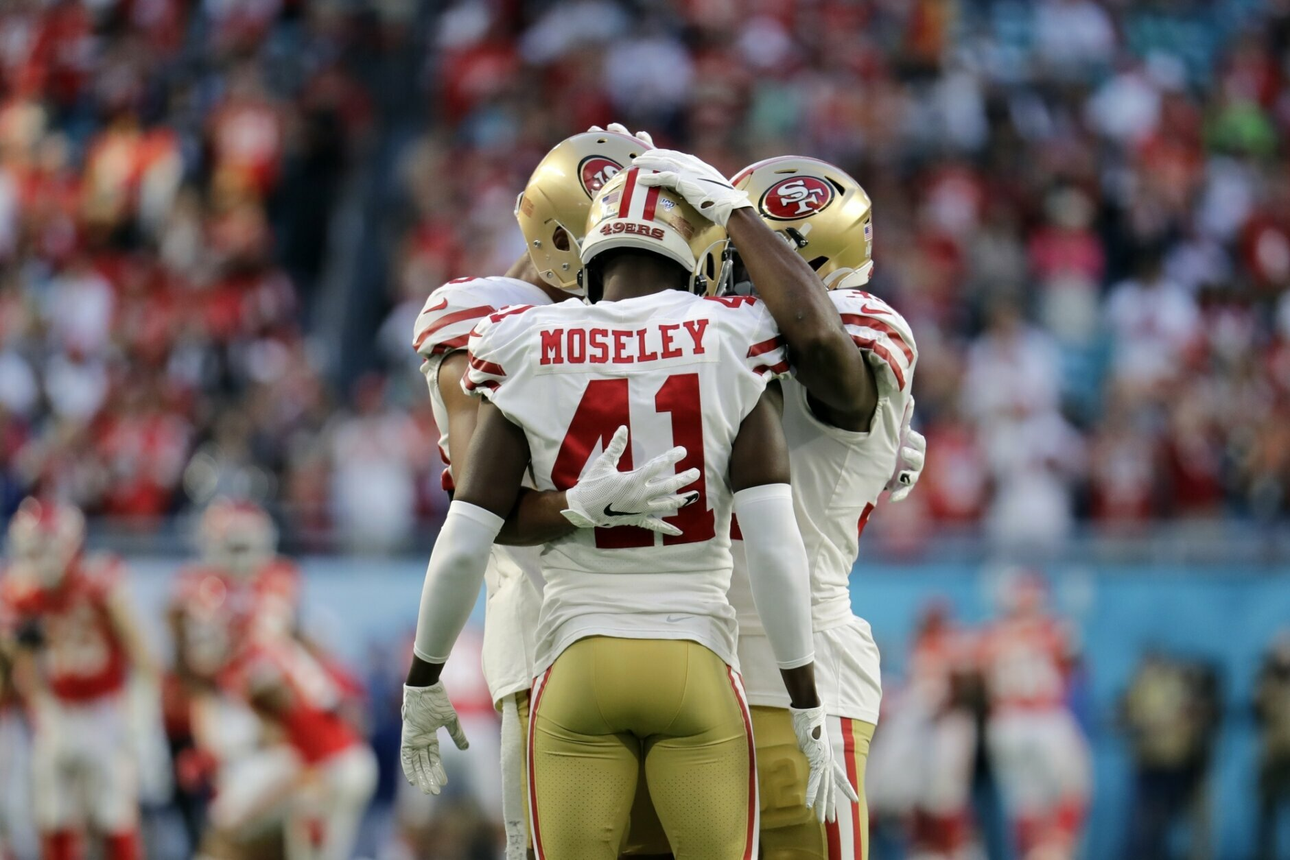San Francisco 49ers' Ahkello Witherspoon, Emmanuel Moseley and D.J. Reed Jr., from left, huddle before the NFL Super Bowl 54 football game between the San Francisco 49ers and Kansas City Chiefs Sunday, Feb. 2, 2020, in Miami Gardens, Fla. (AP Photo/Lynne Sladky)
