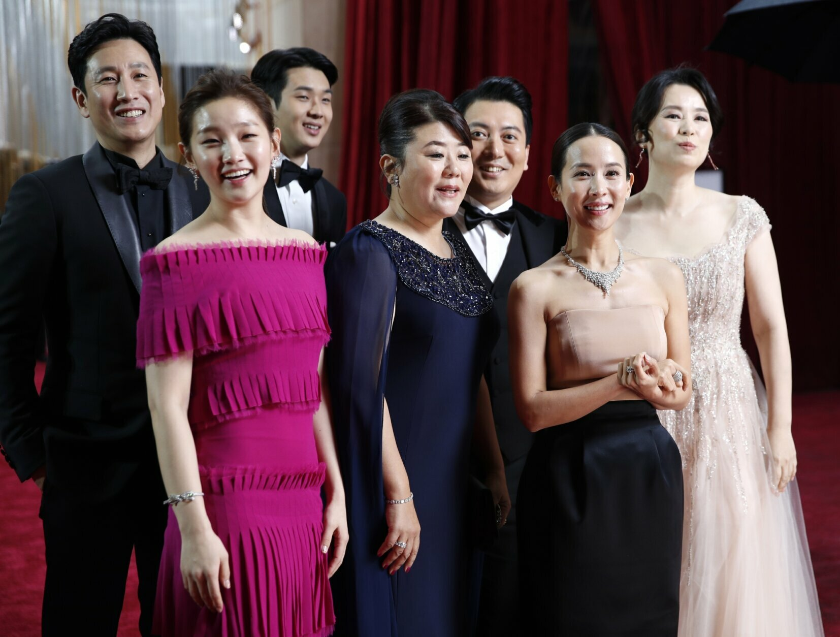 """The cast of """"Parasite"""" arrives at the Oscars on Sunday, Feb. 9, 2020, at the Dolby Theatre in Los Angeles. (AP Photo/John Locher)"""