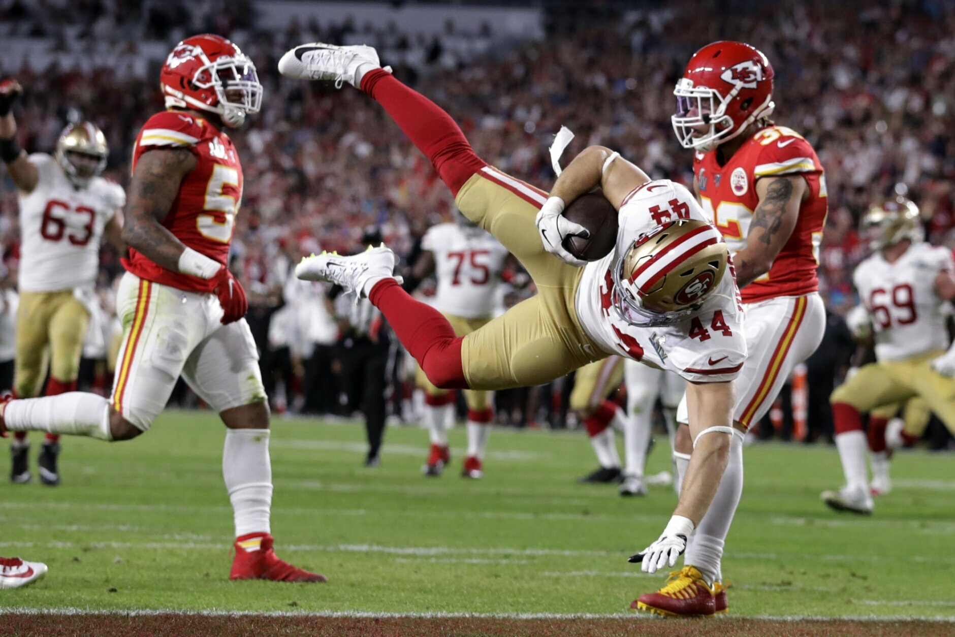 San Francisco 49ers' Kyle Juszczyk (44) falls into the end zone for a touchdown the Kansas City Chiefs during the first half of the NFL Super Bowl 54 football game Sunday, Feb. 2, 2020, in Miami Gardens, Fla. (AP Photo/Lynne Sladky)