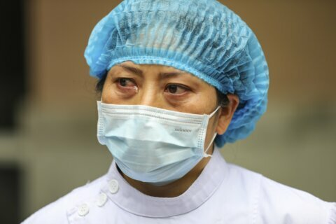 Virus cases rise as experts question China's numbers