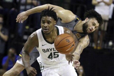 No. 1 Baylor tops No. 14 W Virginia 70-59, ties Big 12 mark