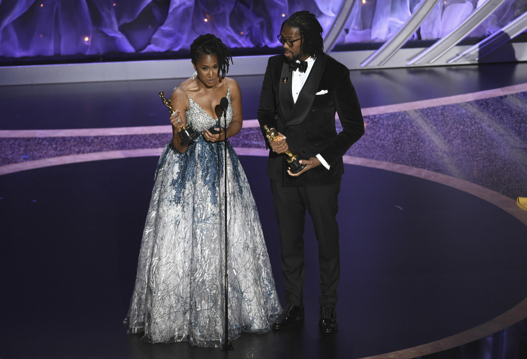 """Karen Rupert Toliver, left, and Matthew A. Cherry accept the award for best animated short film for """"Hair Love"""" at the Oscars on Sunday, Feb. 9, 2020, at the Dolby Theatre in Los Angeles. (AP Photo/Chris Pizzello)"""
