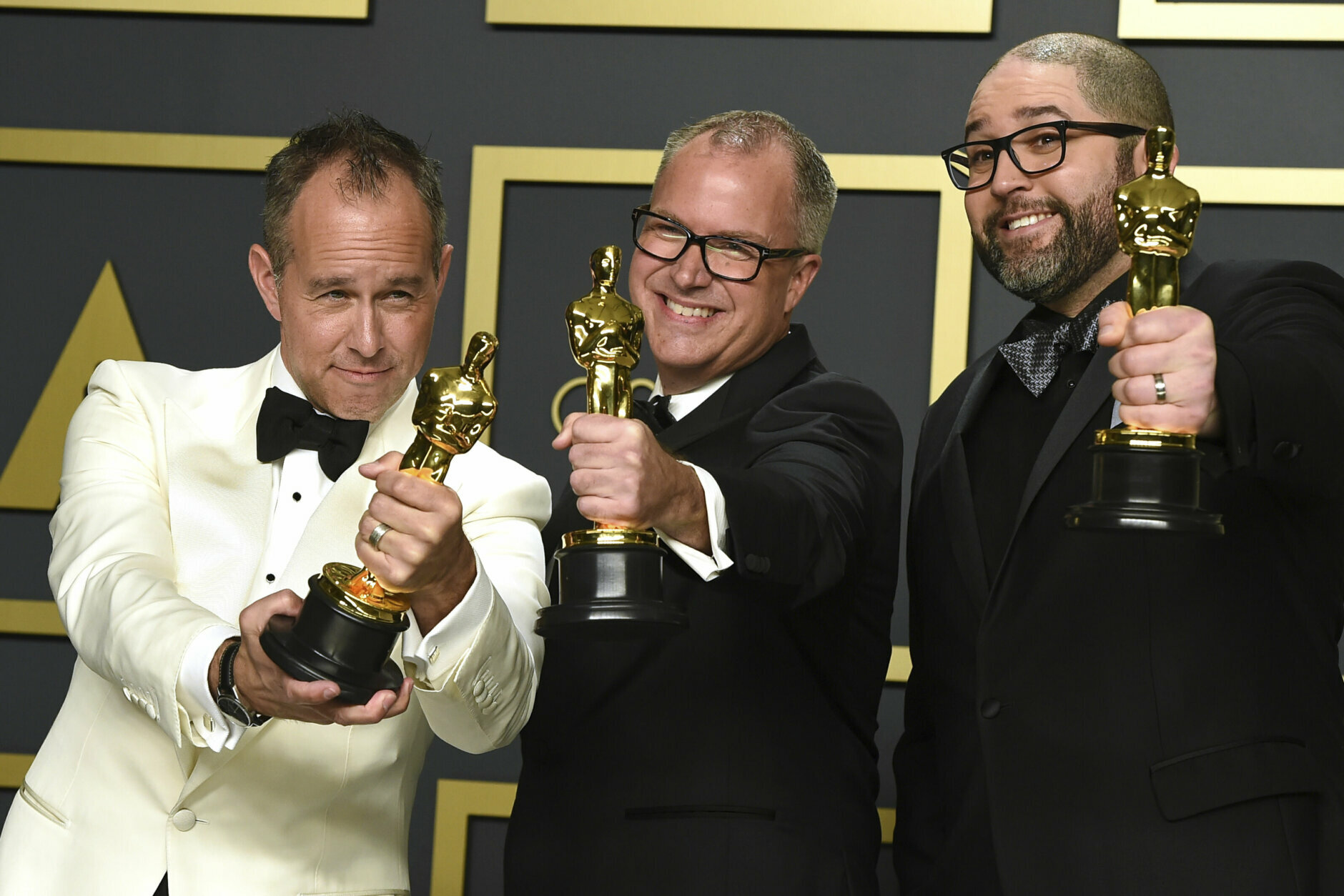 """Jonas Rivera, from left, Mark Nielsen, and Josh Cooley, winners of the award for best animated feature film for """"Toy Story 4"""", pose in the press room at the Oscars on Sunday, Feb. 9, 2020, at the Dolby Theatre in Los Angeles. (Photo by Jordan Strauss/Invision/AP)"""