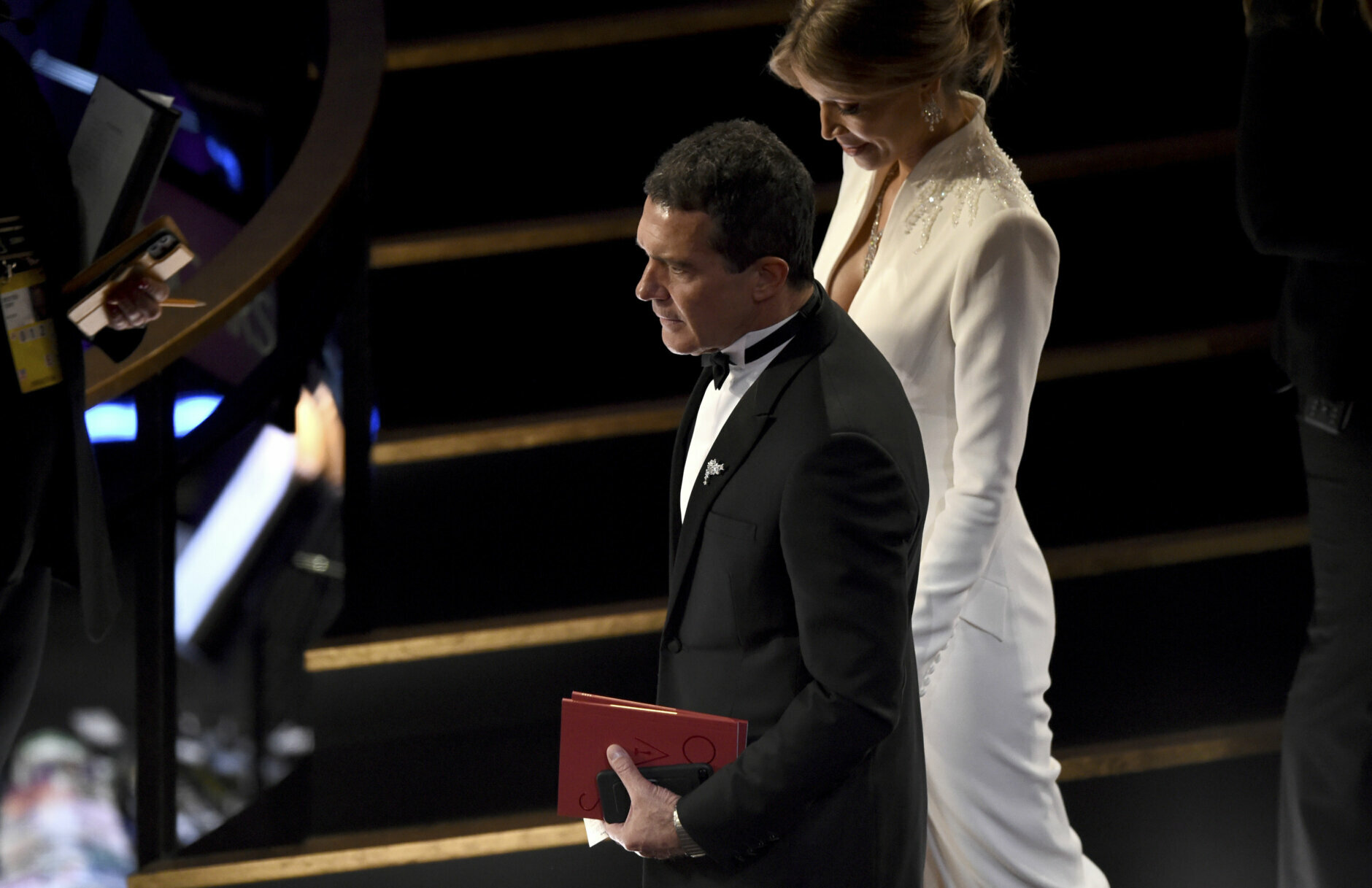 Antonio Banderas, left and Nicole Kimpel appear in the audience at the Oscars on Sunday, Feb. 9, 2020, at the Dolby Theatre in Los Angeles. (AP Photo/Chris Pizzello)