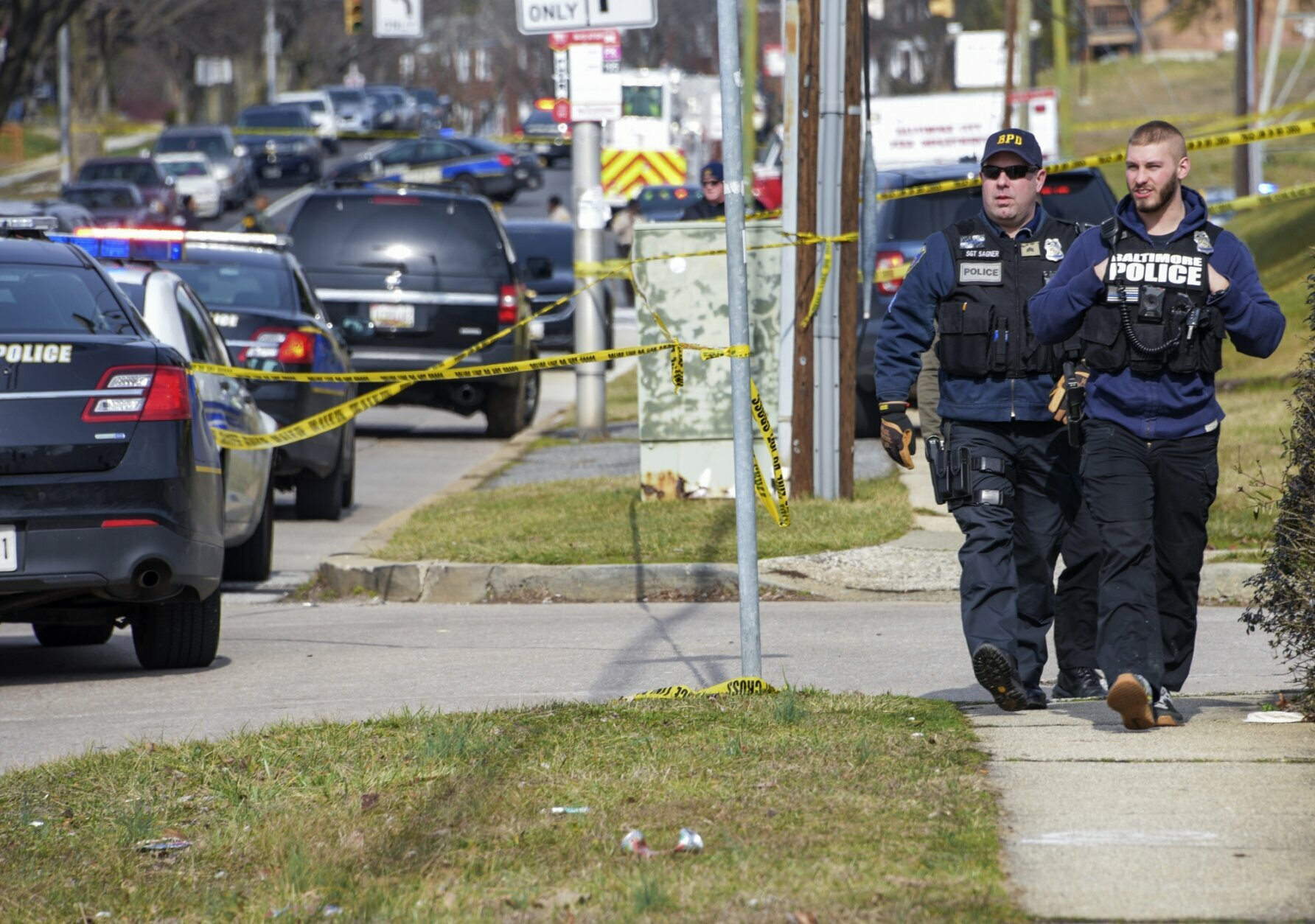 Baltimore County police are on the scene of a shooting in Northeast Baltimore Wednesday afternoon, Feb. 12, 2020. Two law enforcement officers with a fugitive task force were injured and a suspect died in a shooting Wednesday in Baltimore, the U.S. Marshals Service said. (Ulysses Munoz/The Baltimore Sun via AP)
