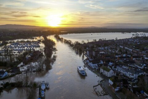 Storm-swollen rivers surge in UK, severe flood alerts issued
