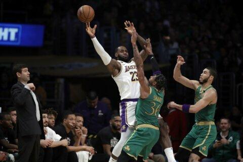 LeBron's clutch jumper sends Lakers past Celtics 114-112