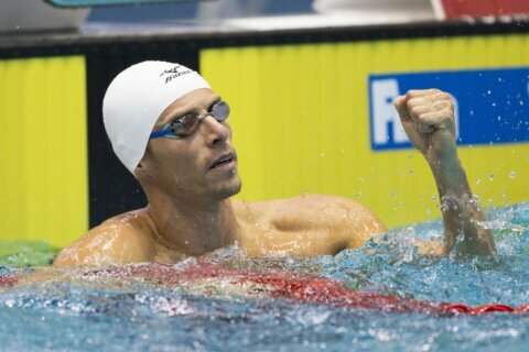 Ex-Olympic swim champ blames contamination for failed test