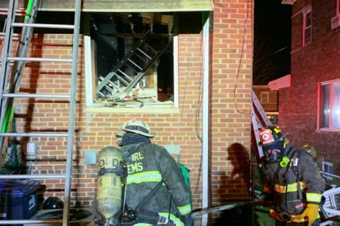 Woman dies after she's rescued during Northeast DC apartment blaze