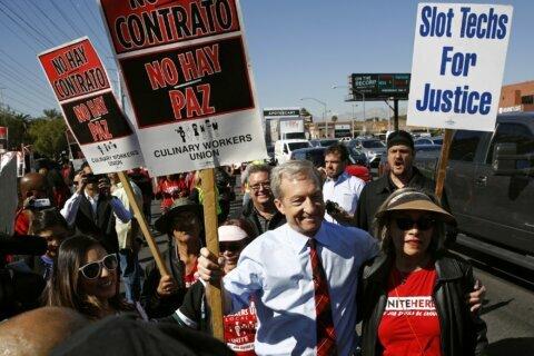 The Latest: Protesters hound Buttigieg on minimum wage