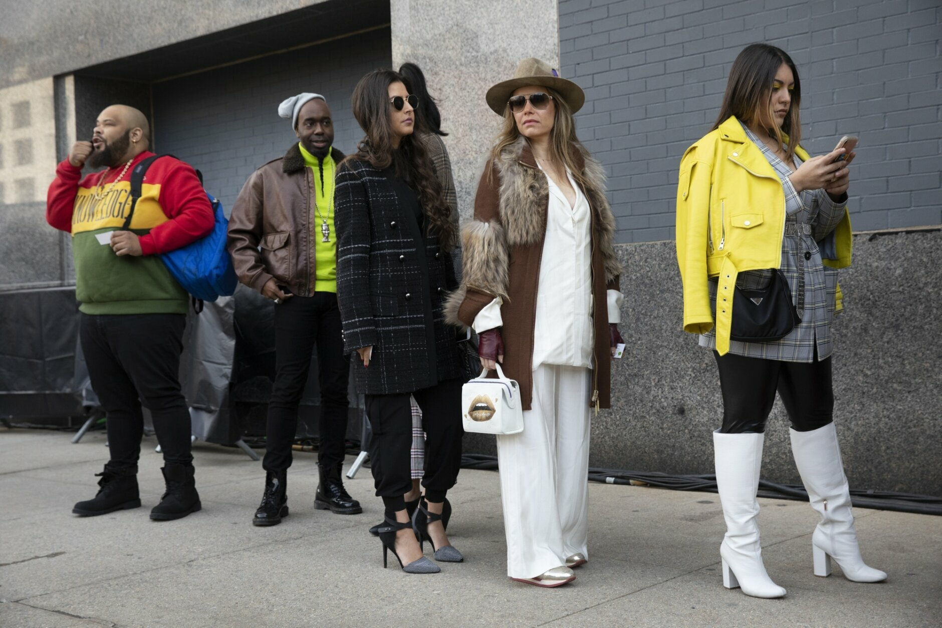 Fashionistas wait in line to enter a show during Fashion Week, Wednesday, Feb. 12, 2020, in New York. (AP Photo/Mark Lennihan)