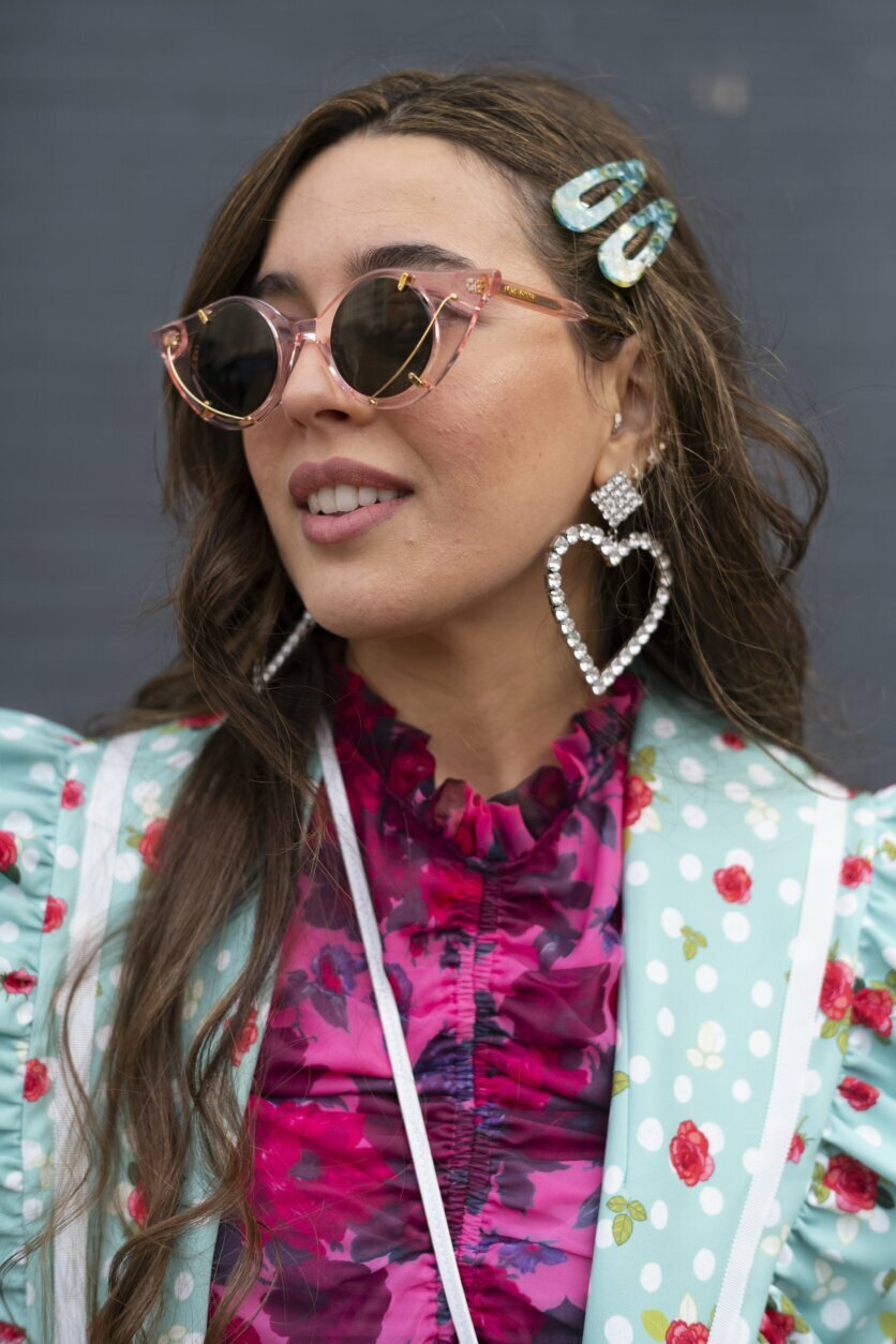 Cici Celia, with thefashiongazette.com, poses for a photo while waiting to attend a show during Fashion Week, Wednesday, Feb. 12, 2020, in New York. (AP Photo/Mark Lennihan)