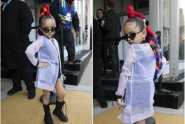 Taylen Biggs, 6, poses for photos outside of a show during Fashion Week, Wednesday, Feb. 12, 2020, in New York. (AP Photo/Mark Lennihan)