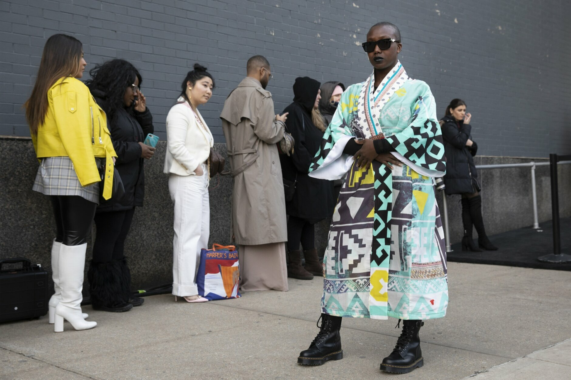 Sabrina-Anne Sarpong, founder of British media platform DSTNGR, poses for photographers outside a show during Fashion Week, Wednesday, Feb. 12, 2020, in New York. (AP Photo/Mark Lennihan)