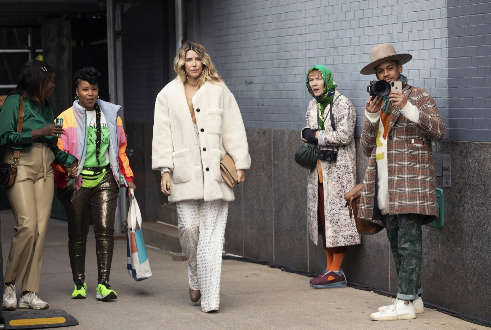 Photographer Karston Tannis, right, works outside a show during Fashion Week, Wednesday, Feb. 12, 2020, in New York. (AP Photo/Mark Lennihan)