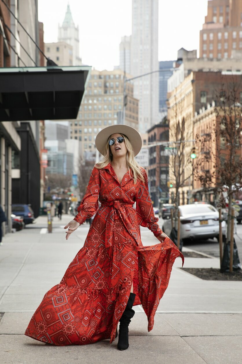 Argentine designer Mery Garavilla poses for photographers in one of her designs after attending a show during Fashion Week, Wednesday, Feb. 12, 2020, in New York. (AP Photo/Mark Lennihan)