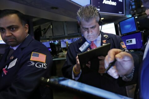 S&P 500 spins lower in choppy trading as caution returns