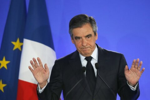 Former French prime minister and wife go on trial for fraud