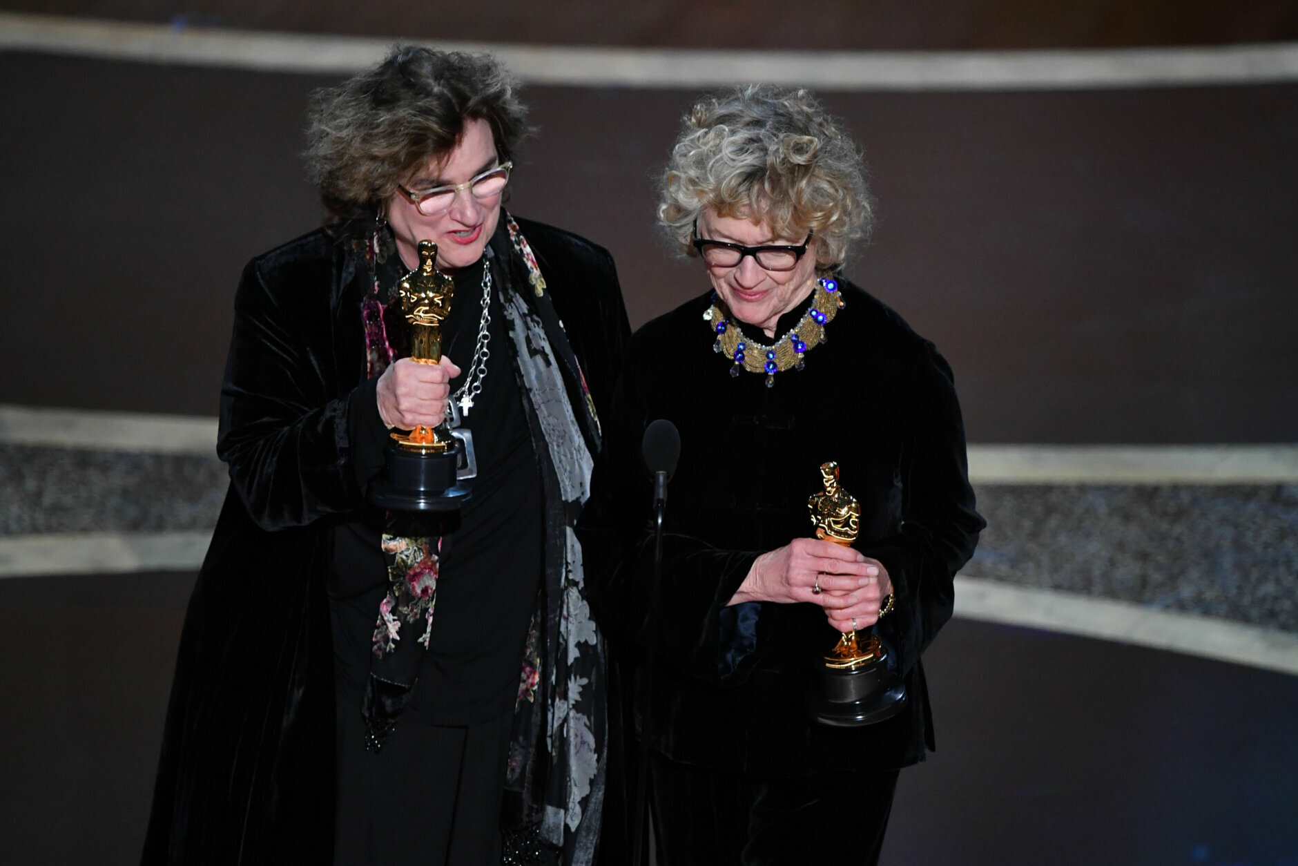 """Nancy Haigh (L) and Barbara Ling accept the award for Best Production Design for """"Once upon a Time...in Hollywood"""" during the 92nd Oscars at the Dolby Theatre in Hollywood, California on February 9, 2020. (Photo by Mark RALSTON / AFP) (Photo by MARK RALSTON/AFP via Getty Images)"""