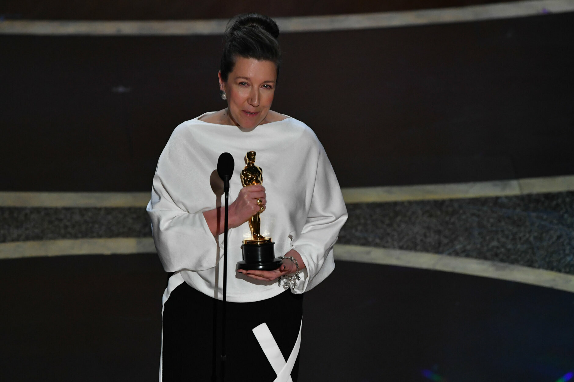 """British costume designer Jacqueline Durran accepts the award for Best Costume Design for """"Little Women"""" during the 92nd Oscars at the Dolby Theatre in Hollywood, California on February 9, 2020. (Photo by Mark RALSTON / AFP) (Photo by MARK RALSTON/AFP via Getty Images)"""