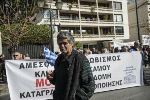 Greek islands step up protests at migrant detention plan