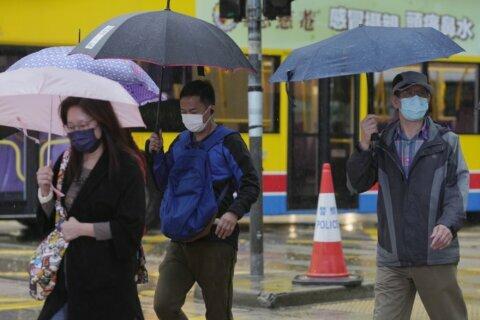Amid protests and virus, China shuffles Hong Kong officials