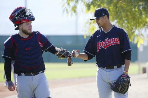 Indians' Carrasco hurts leg in workout, undergoing tests