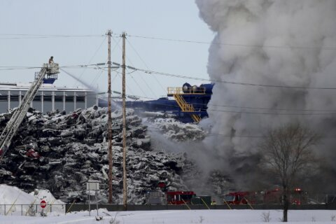 Police: Minnesota recycling plant fire under control for now