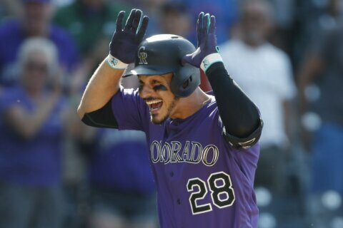 Nolan Arenado ready to get to work with Rockies _ for now