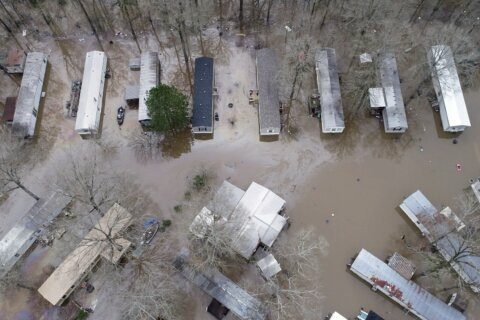 Soggy neighborhoods under flash-flood warning in Mississippi