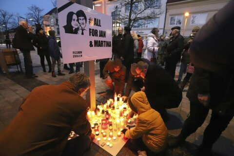 Slovaks mark anniversary of slayings of journalist, fiancee