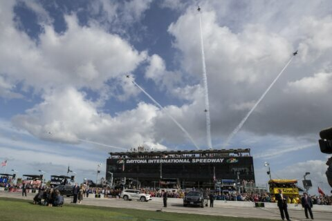 Daytona 500 resumes without president, pomp or packed house