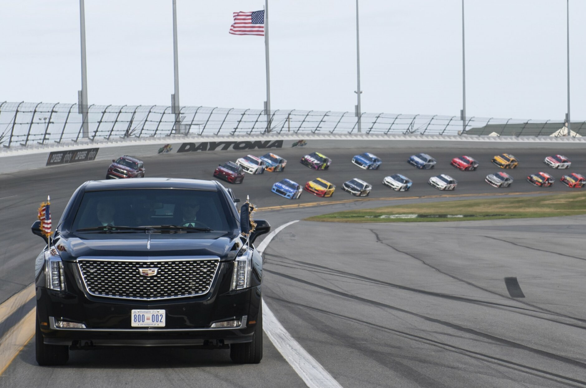 President Donald Trump and first lady Melania Trump ride in the presidential limousine as they take a pace lap ahead of the start of the NASCAR Daytona 500 auto race at Daytona International Speedway in Daytona Beach, Fla., Sunday, Feb. 16, 2020. (Saul Loeb/Pool Photo via AP)