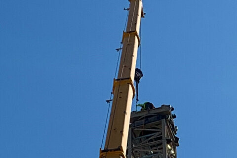 Injured man rescued after becoming trapped over 200 feet up on crane in DC