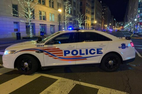 DC man remains held after deadly downtown shooting