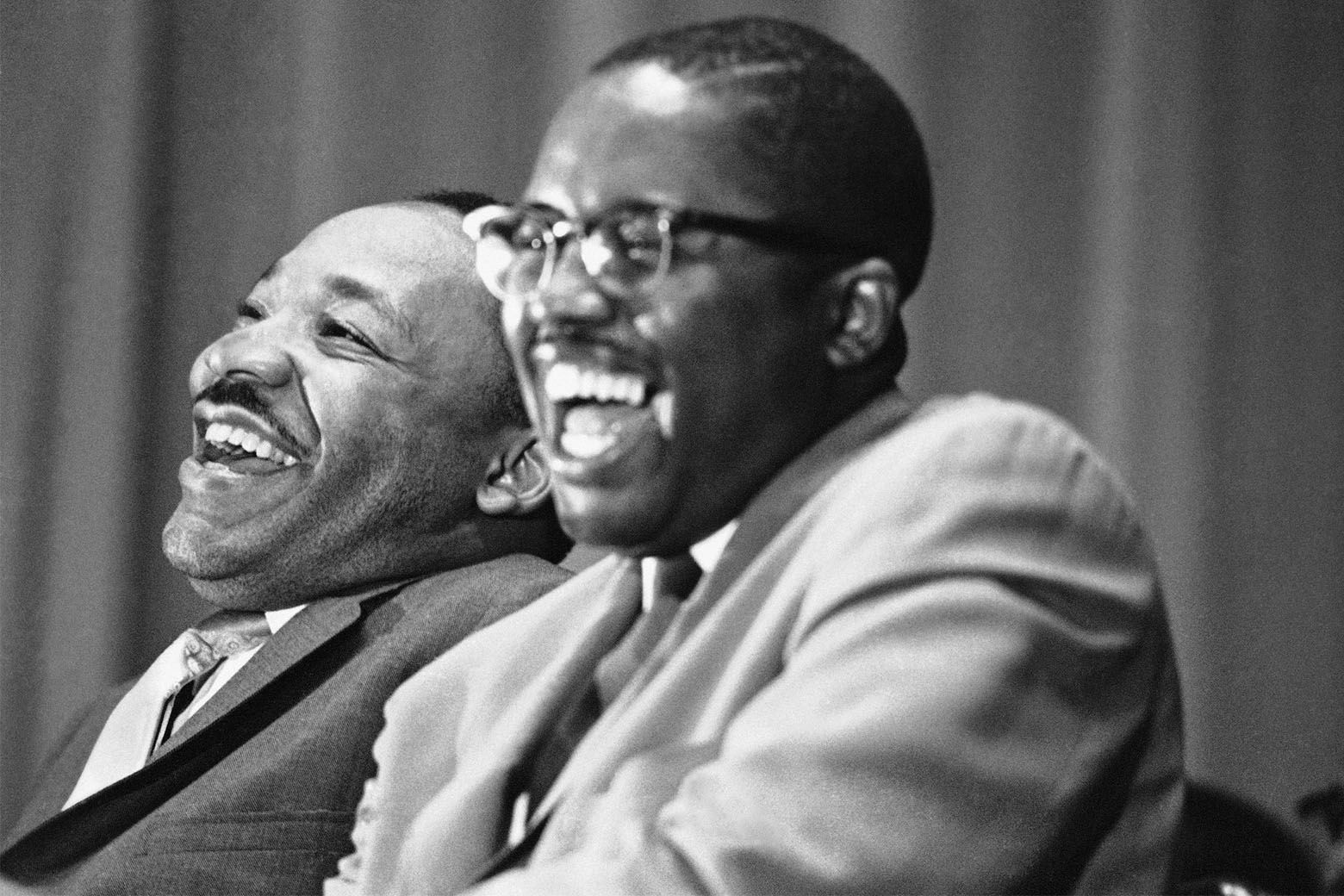 Civil rights leader Martin Luther King Jr., left, and Tuskegee attorney Fred Gray break into laughter at a joke told by a speaker at a political rally in Tuskegee, Alabama, April 29, 1966. Rev. King is on a whistle-stop tour through Alabama to encourage block-voting by blacks in the May 3 Alabama primary. Gray is a candidate for a seat in the Alabama House of Representatives. (AP Photo/Jack Thornell)