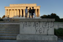 """Spray paint that reads """"Yall Not Tired Yet?"""" is seen on the base fo the Lincoln Memorial on the National Mall in Washington, early Sunday, May 31, 2020, the morning after protests over the death of George Floyd. Floyd died after being restrained by Minneapolis police officers on Memorial Day. (AP Photo/Carolyn Kaster)"""