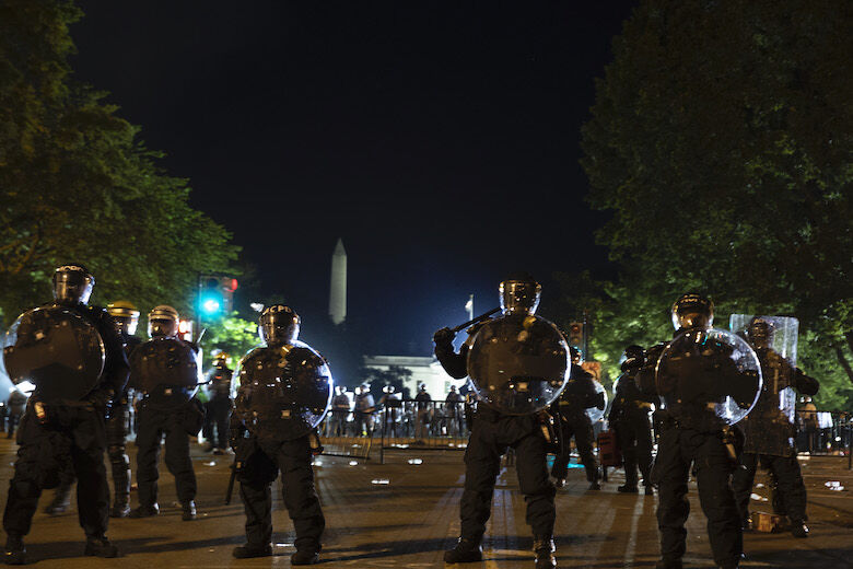 <p>WASHINGTON, DC &#8211; MAY 31: Police work to keep demonstrators back during a protest on May 31, 2020 in Washington, DC. Across the country, protests were set off by the recent death of George Floyd in Minneapolis, Minnesota while in police custody, the most recent in a series of deaths of black Americans by the police. Minneapolis police officer Derek Chauvin was taken into custody and charged with third-degree murder and manslaughter. (Photo by Tasos Katopodis/Getty Images)</p>