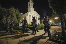<p>Police form a line infront of St. John&#8217;s Episcopal Church as demonstrators protest the death of George Floyd, Sunday, May 31, 2020, near the White House in Washington. Floyd died after being restrained by Minneapolis police officers (AP Photo/Alex Brandon)</p>