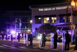 <p>Police stand in front of The Shops At Wisconsin Place in Chevy Chase, Maryland.</p>