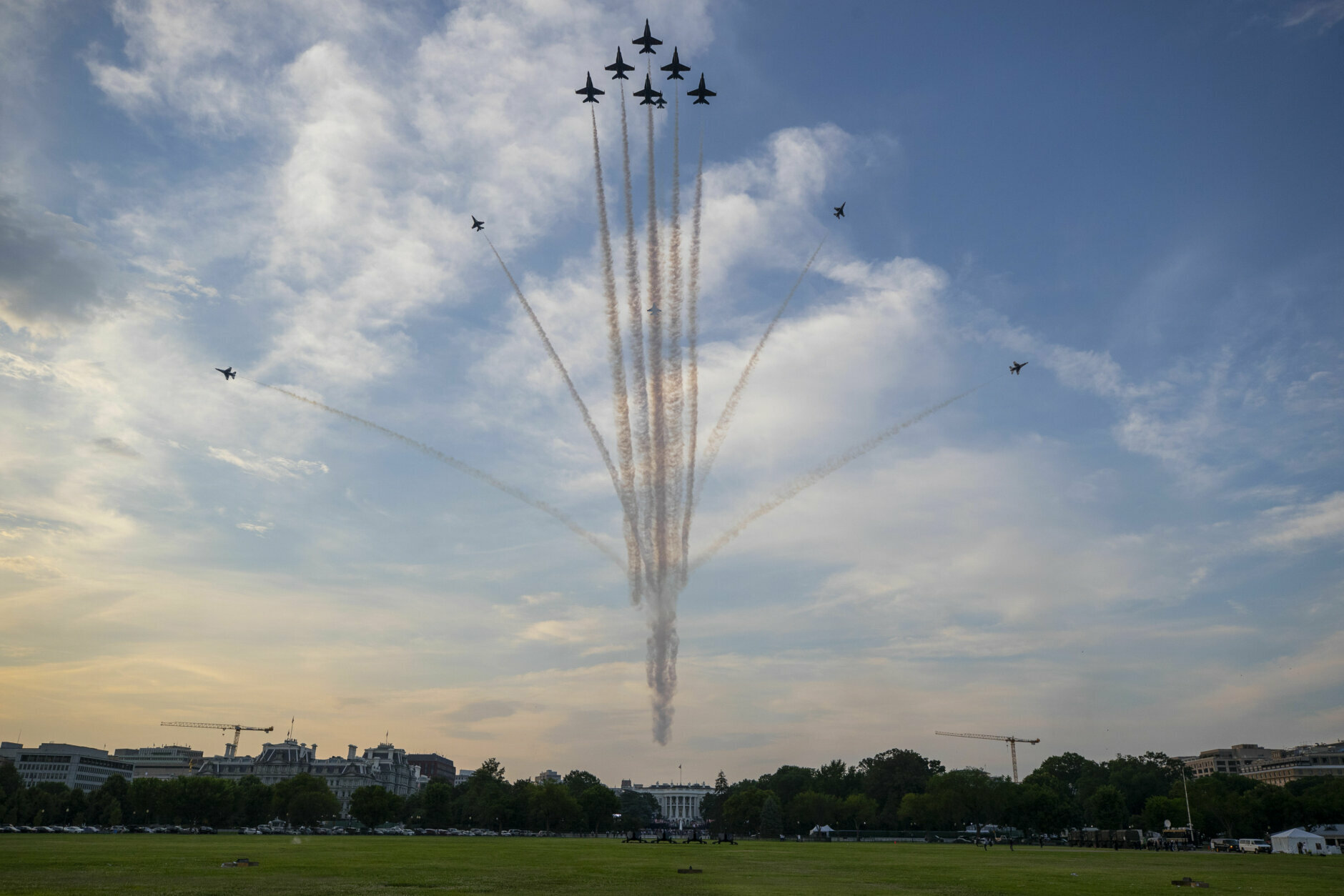 """The U.S. Navy Blue Angels and U.S. Air Force Thunderbirds fly over the White House during a """"Salute to America"""" event on the South Lawn of the White House, Saturday, July 4, 2020, in Washington. (AP Photo/Alex Brandon)"""