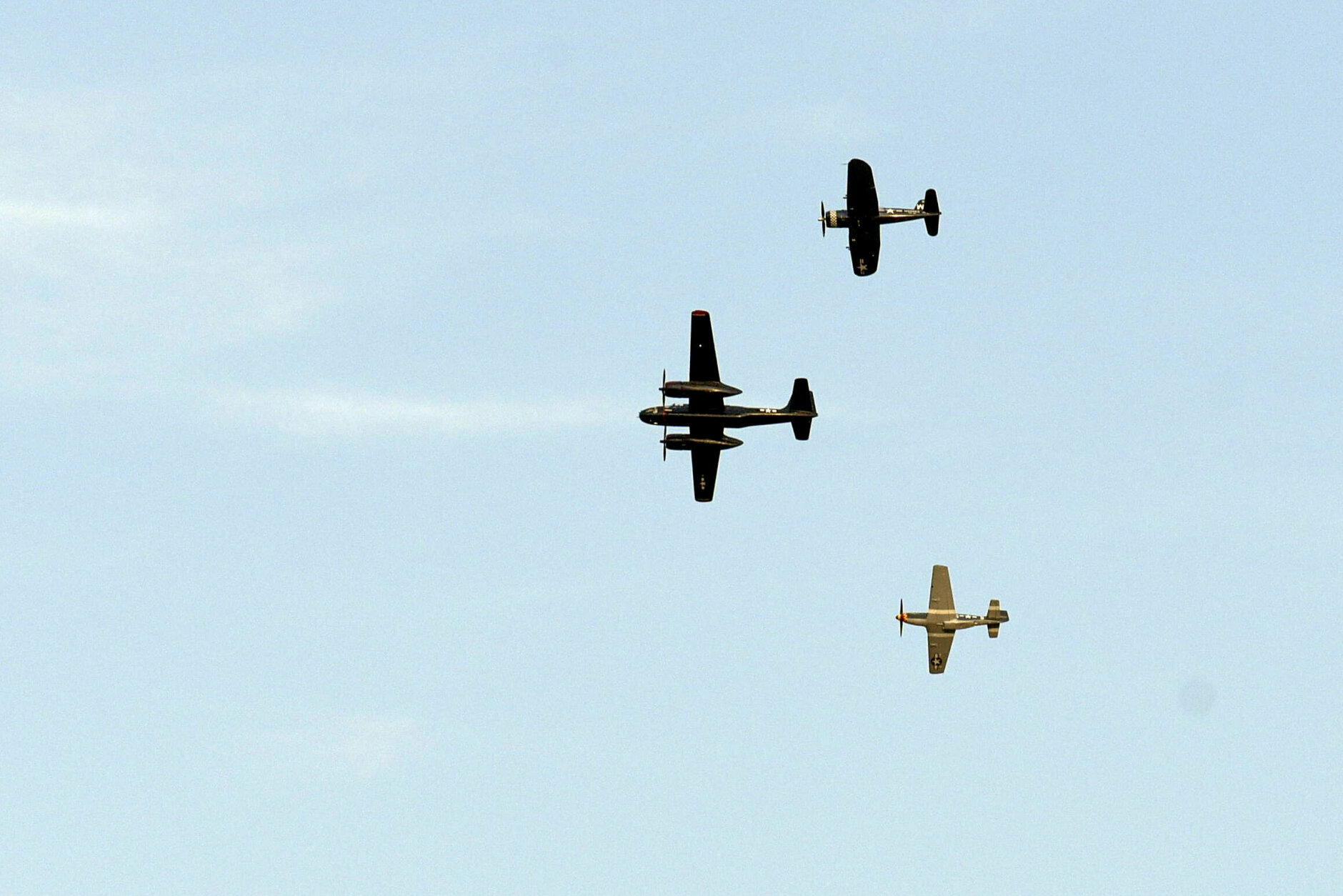World War II military aircraft fly over the National Mall in Washington on Saturday, July 4, 2020. (AP Photo/Cliff Owen)