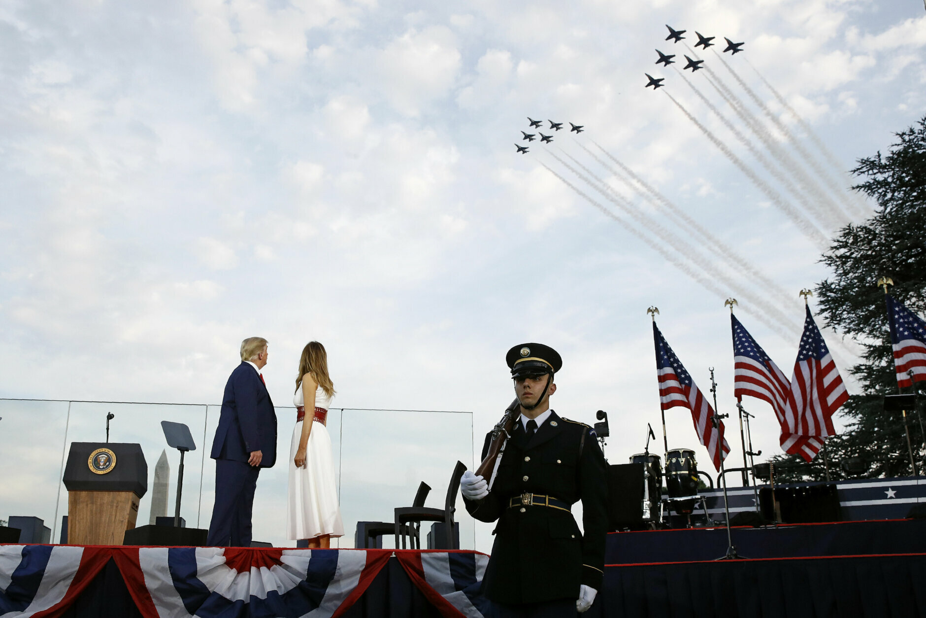 """President Donald Trump and first lady Melania Trump watch as the U.S. Air Force Thunderbirds and U.S. Navy Blue Angels perform a flyover during a """"Salute to America"""" event on the South Lawn of the White House, Saturday, July 4, 2020, in Washington. (AP Photo/Patrick Semansky)"""