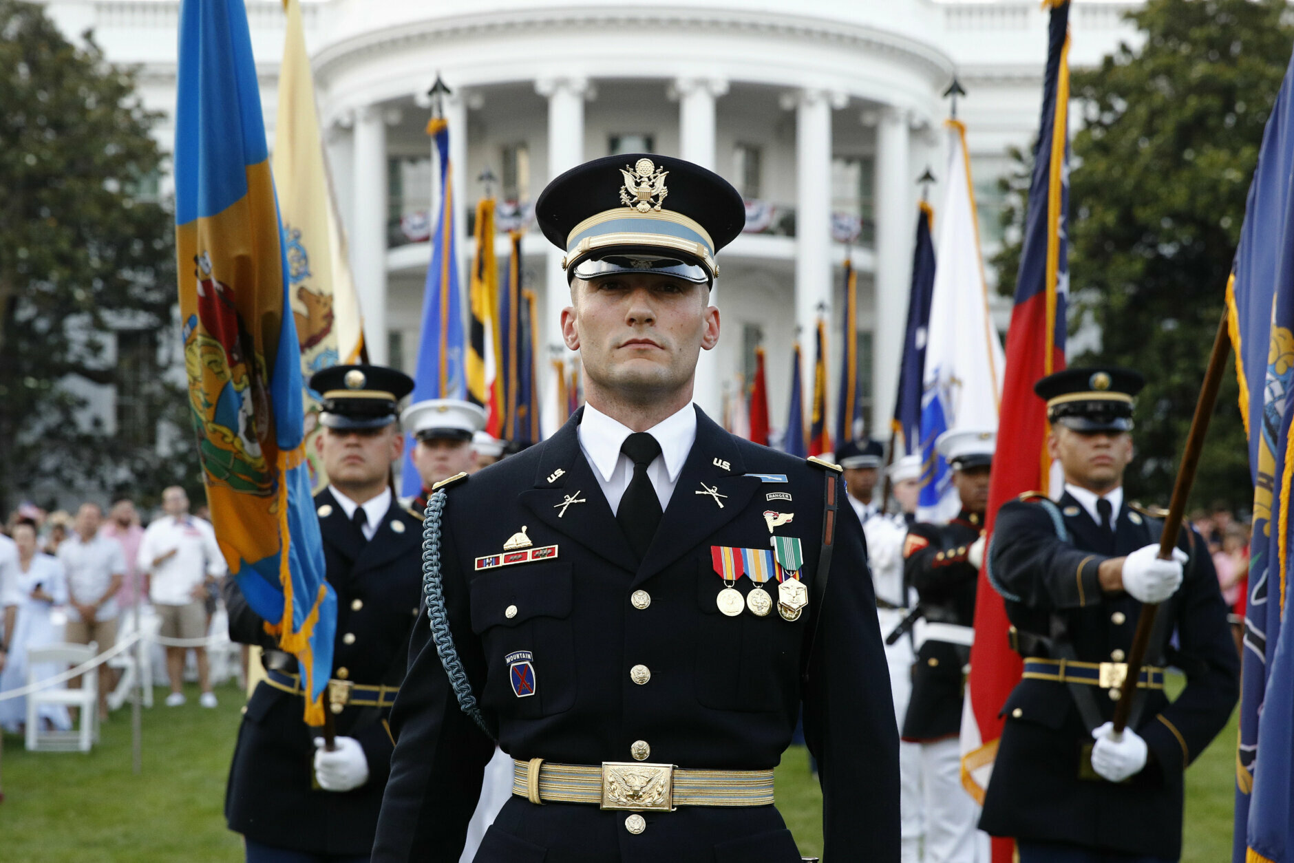 """Service members stand on the South Lawn of the White House during a """"Salute to America"""" event with President Donald Trump and first lady Melania Trump on the South Lawn of the White House, Saturday, July 4, 2020, in Washington. (AP Photo/Patrick Semansky)"""