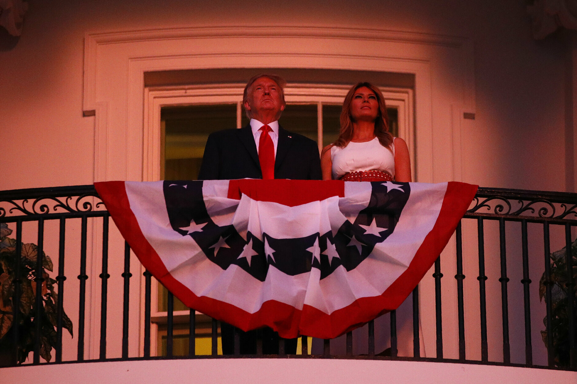 """President Donald Trump and first lady Melania Trump stand on the Truman Balcony of the White House as they watch a fireworks display during a """"Salute to America"""" event, Saturday, July 4, 2020, in Washington. (AP Photo/Patrick Semansky)"""
