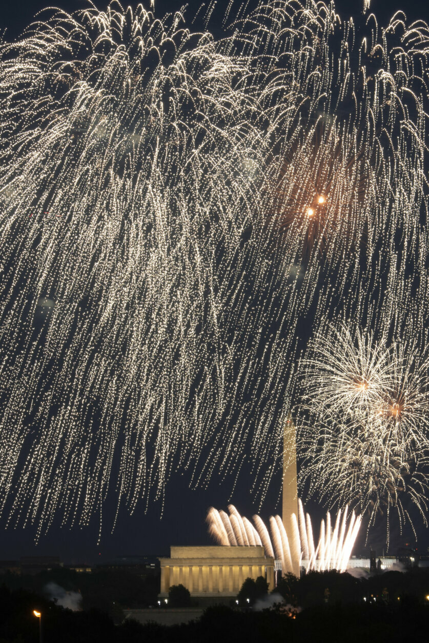 Fourth of July fireworks explode over the Lincoln Memorial, the Washington Monument and the U.S. Capitol, along the National Mall in Washington, Saturday, July 4, 2020. (AP Photo/Cliff Owen)