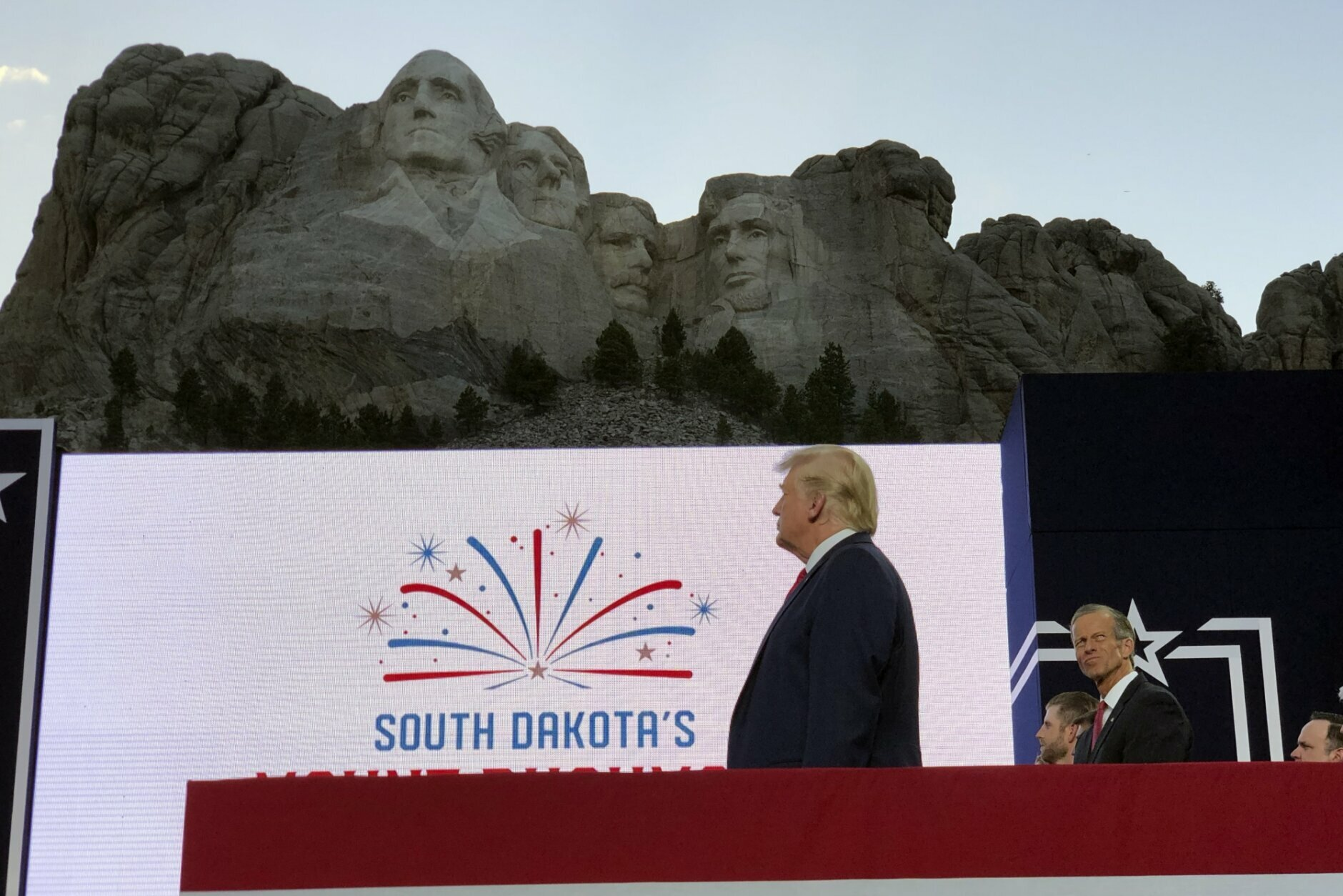 President Donald Trump stands on stage before he speaks at the Mount Rushmore National Monument Friday, July 3, 2020, in Keystone, S.D. (AP Photo/Alex Brandon)